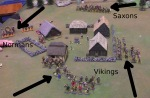 The Normans are forced to waste time by the lady they 'rescued'. The Saxons form up and advance on the village.