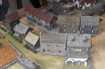 The seemingly empty town actually crawling with German infantry.
