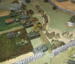 Infantry use the dry river bed for cover.