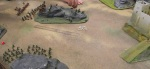 The rough ground is scouted. The Royal Artillery crew of the Gatling (on the elephants) is wiped out by the fort's gun.