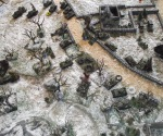 The first defense line (StuGs and infantry) is taken.