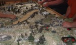 Soviets reach the road across from the German positions and a bloody exchange of fire begins.