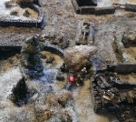 Russian infantry and a tank cross the bridge, but fail to take the objective buildings.