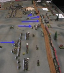 French infantry break through the British line behind the crest.  La Haie Sainte and the sandpit are under fire.