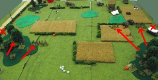 The British feint on the left and attack on the right, using the woods for cover. Both British tanks are knocked out.