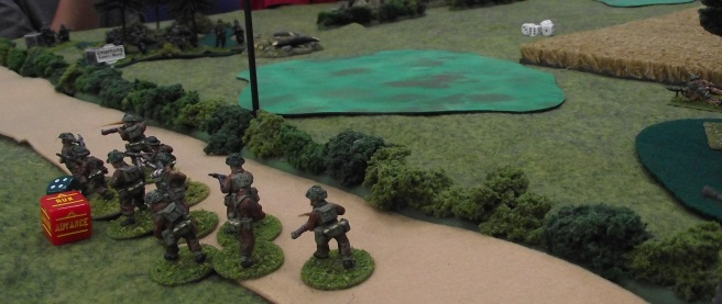 As the right flank attack is slowed by heavy casualties, the left is thrown in.