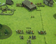 The Vikings must take the three buildings from the Saxons.