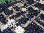 The left squad covers Genestealer entry points on the left while the others move toward the objective.
