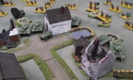 Russian tanks enter the town with infantry close behind.