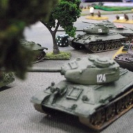 Russian tanks flank the town and take cover from the expected German reinforcements.