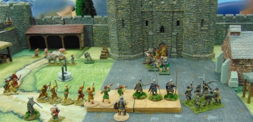 Nottingham guards clear some rebels away from the Keep door.